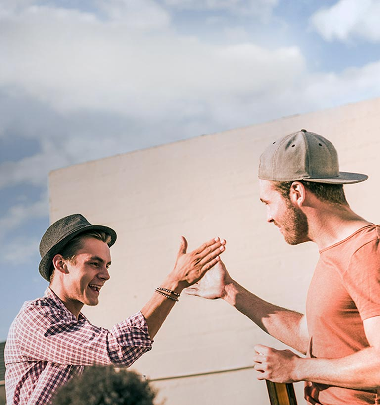 Two young guys high-fiving